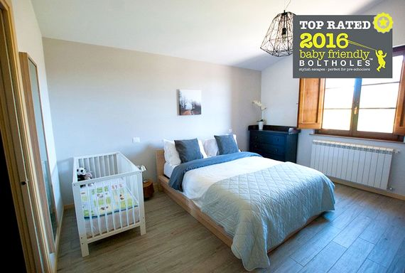 The large bedroom with space for a cot and en-suite bathroom