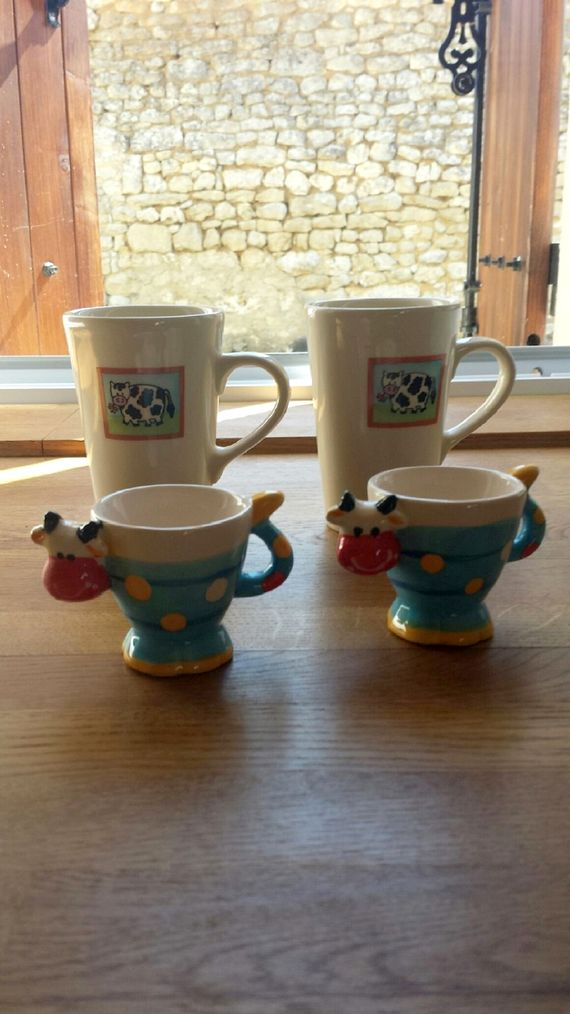 ...... entertain the children with cow mugs and cow egg cups !