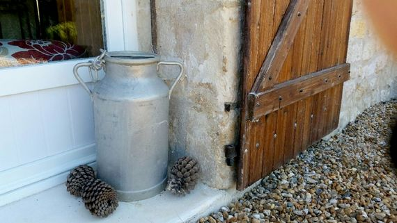 Milk churns at the entrance