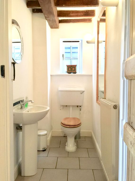 Downstairs wash room next to single bedroom