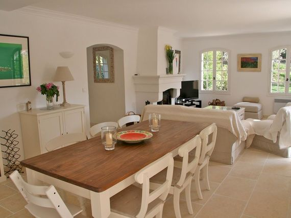 Dining area with French windows leading to the upper fenced terrace.