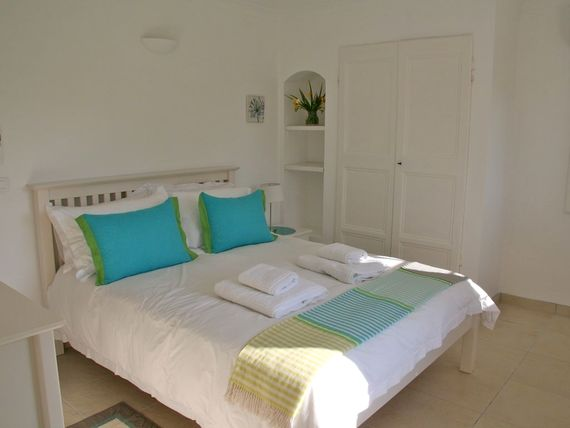 Double bedroom (Lower floor) with private terrace, seating and views over the gardens.