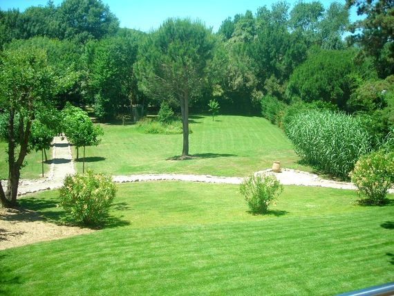 Views over the extensive parkland gardens with a petanque area under the trees.