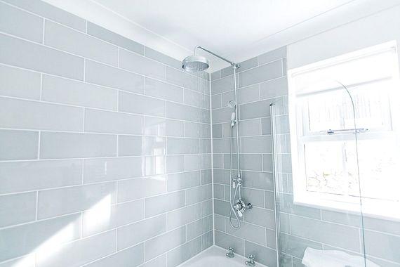 Family bathroom with bath tub and rain shower