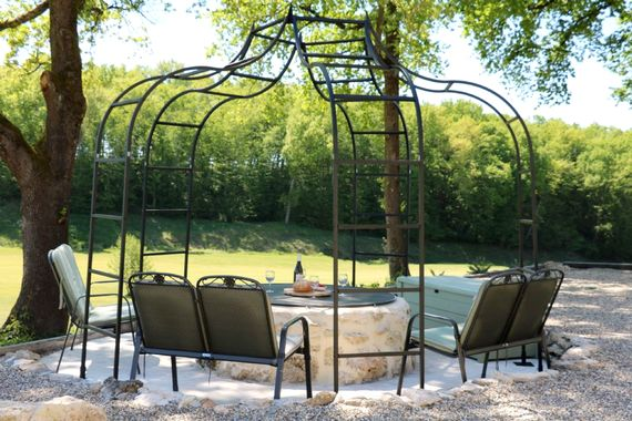 The lower garden is a cool area under the oak trees with beautiful views down the valley. Relaxing under the arbour is a lovely area for reading or an aperitif.