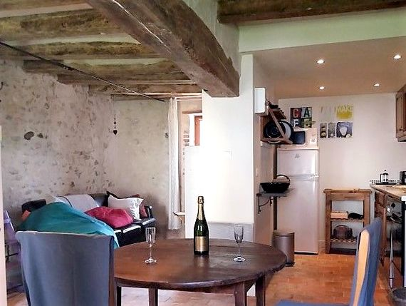 Well equipped for four downstairs is open plan in traditional oak beam stone cottage