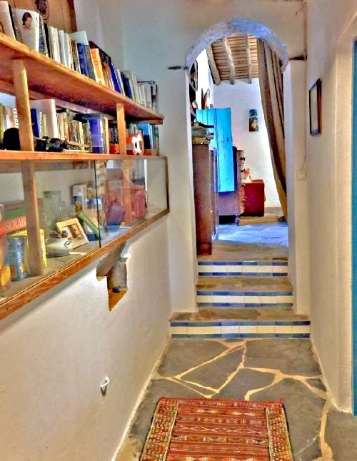 Lots of books and games for all ages in the hallway which leads to the bedrooms and bathroom