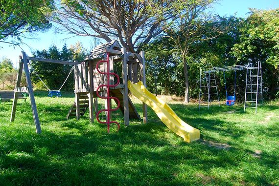 Slides, swings, a castle, a play house ....something for all ages