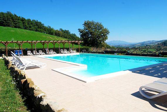 The pool with heated splash pool and slide