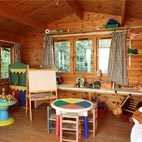 There's a heated (in winter) play cabin which is popular with child year round, not just on rainy days.