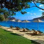 The resort has a private beach, backed by lush lawns and olive trees. There's a beachside snack bar and waterports.